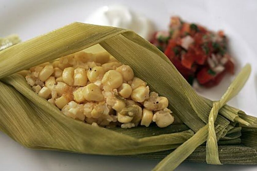 TAMAL: Corn steams up soft and light in fresh husks, with chile and cheese in the mix.