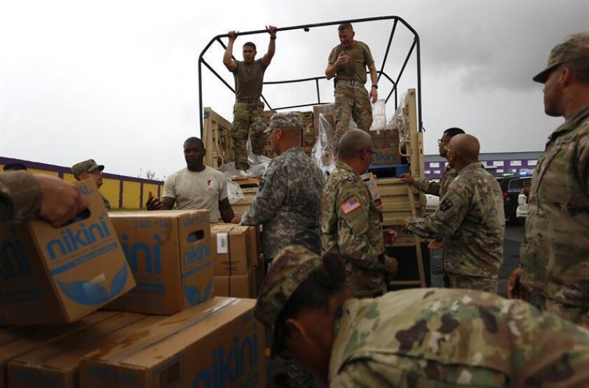 Los trabajos del Comité Noviembre que visitó Puerto Rico para ofrecer ayuda voluntaria a los afectados por los huracanes que arrasaron la isla el pasado mes se septiembre culminaron este fin de semana. EFE/Archivo