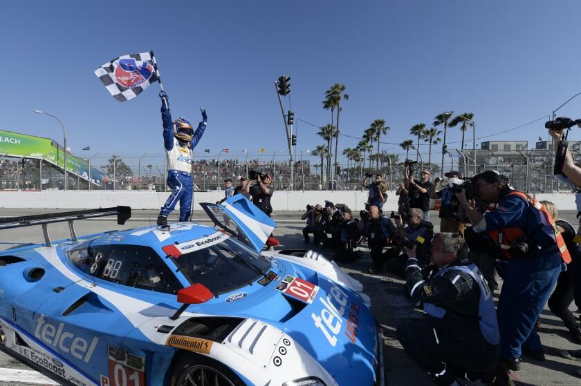 Scott Pruett celebrates his April 2014 championship in the TUDOR United Sportscar Series in Long Beach.