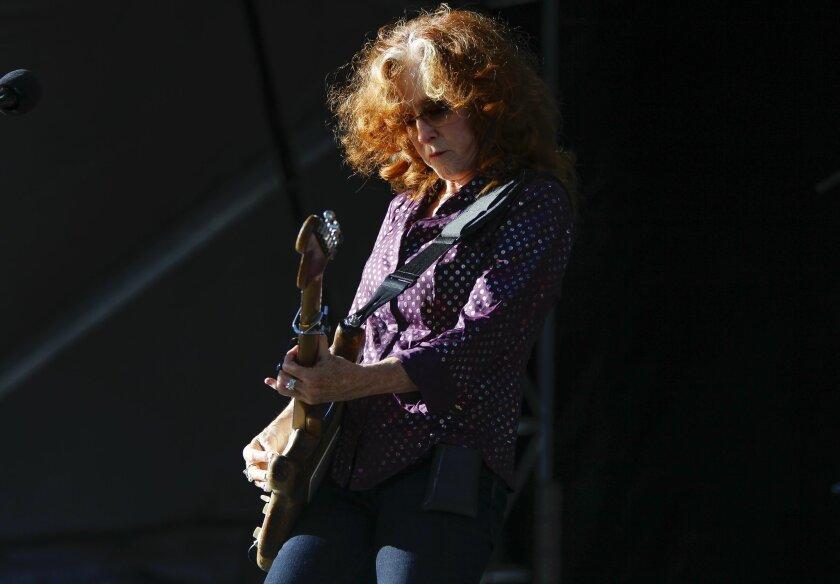 Bonnie Raitt plays he guitar at the Zuma stage.