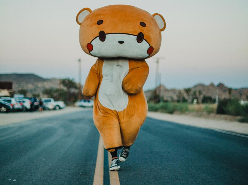 Jessy Larios, 33, of Lynwood, walks for charity in his Bearsun cartoon character costume.