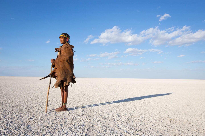 A San Bushwoman walks accross the Makgadikgadi Salt Pans in northeastern Botswana.