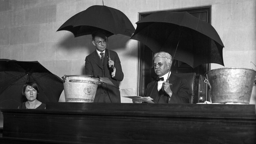 April 16, 1926: An overflowing drain at the Hall of Justice brought out umbrellas and pails in Super
