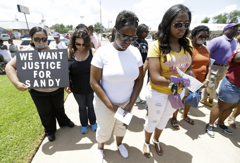 Protesters prayer at rally outside the Waller County Courthouse after a march from the Waller County Jail in Hempstead, Texas, Friday July 17, 2015, to protest the death of Sandra Bland, who was found dead in the jail. Waller County District Attorney Elton Mathis said there were no cameras in Bland's jail cell to show if the Illinois woman hanged herself in the lockup as a medical examiner has ruled. Her relatives and supporters dispute the finding. (Melissa Phillip/Houston Chronicle via AP) MANDATORY CREDIT