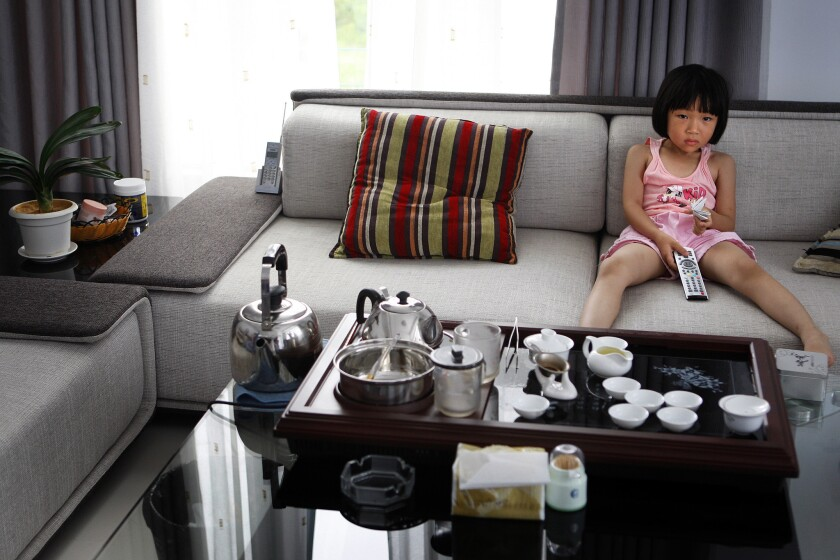 Zhang Yujia, 6, watches cartoons in the house her parents bought in Chao Le village, in eastern China's Fujian province, with a $100,000 interest-free government loan. The rural couple received the money as a reward for agreeing to stick to two girls and not try for a son. For three decades, the world's most populous country has moved aggressively to limit its population growth. Yet the nation's huge and still-growing numbers, along with its rising affluence, are taking a heavy toll on the environment.