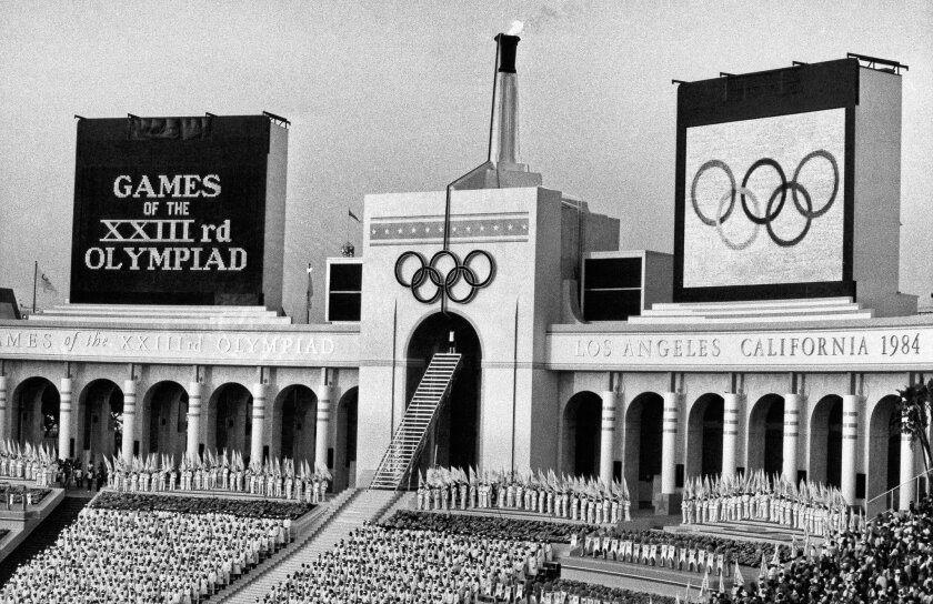 Rafer Johnson lights the Olympic flame at the L.A. Memorial Coliseum during the opening ceremonies of the XXIII Olympiad on July 28, 1984.