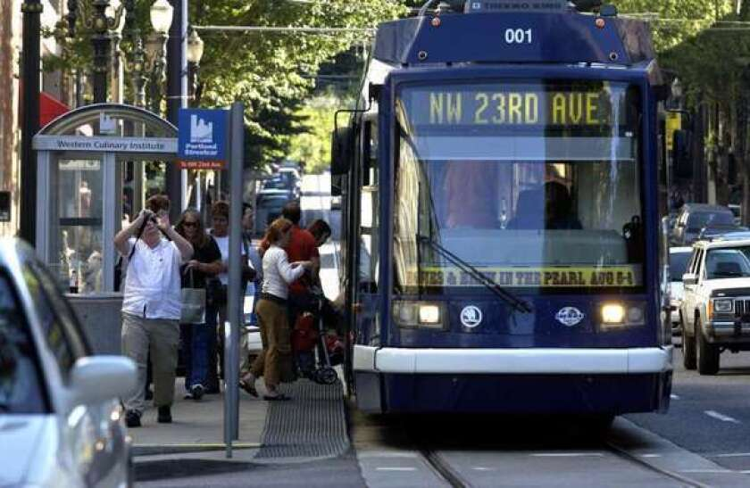Downtown Los Angeles voters will decide later this month whether to tax properties to pay for a streetcar like this one in Portland, Ore.