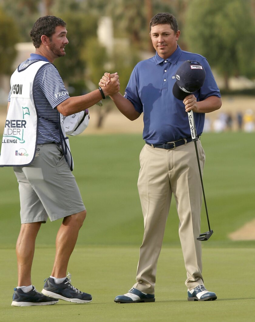 Jason Dufner clasps hands with a caddie after finishing the second round at TPC Stadium Course at PGA West, during the CareerBuilder Challenge golf tournament Friday, Jan. 22, 2016, in La Quinta, Calif. (Jay Calderon/The Desert Sun via AP)