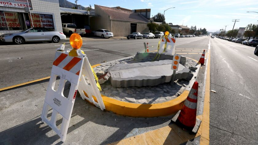 """The """"Welcome to Glendale"""" sign, located on Foothill Boulevard near Lowell Avenue, was hit by a minivan around 4:30 p.m. on Nov. 17, toppling it over for a third time."""