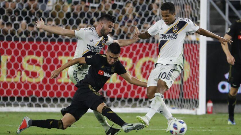 LOS ANGELES, CALIF. -- THURSDAY, JULY 26, 2018: LA Galaxy midfielder Romain Alessandrini, left, an