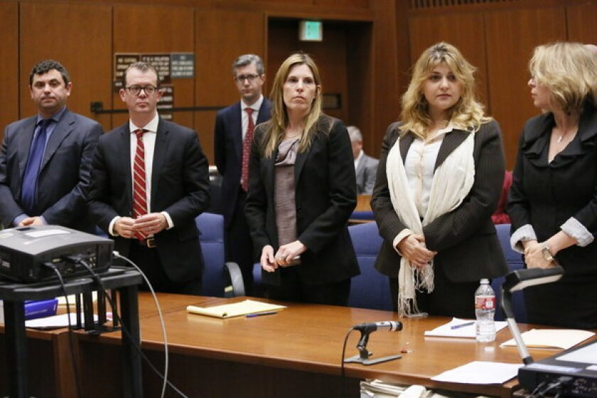 """Yevgeny """"Eugene"""" Selivanov, far left, and Tatyana Berkovich, second from right, were found guilty Friday of several charges related to a case involving the taking or misappropriating of more than $200,000 in public funds."""