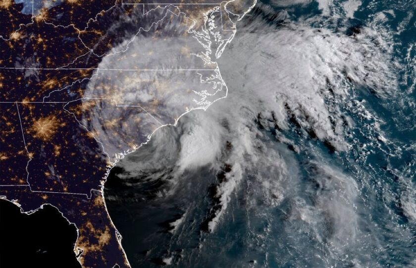 This satellite image provided by the National Oceanic and Atmospheric Administration shows Florence on the East Coast on Saturday.
