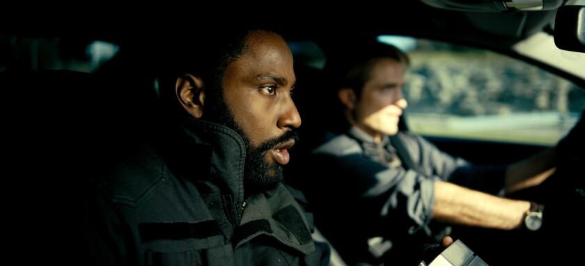 "John David Washington, left, and Robert Pattinson in the movie ""Tenet."""