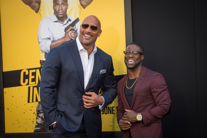 """Dwayne Johnson, left, can command $20 to $25 million for """"Fast & Furious"""" movies, while Kevin Hart, right, is one of the rare stars who don't need franchise to deliver. Now the two are starring in """"Central Intelligence."""""""