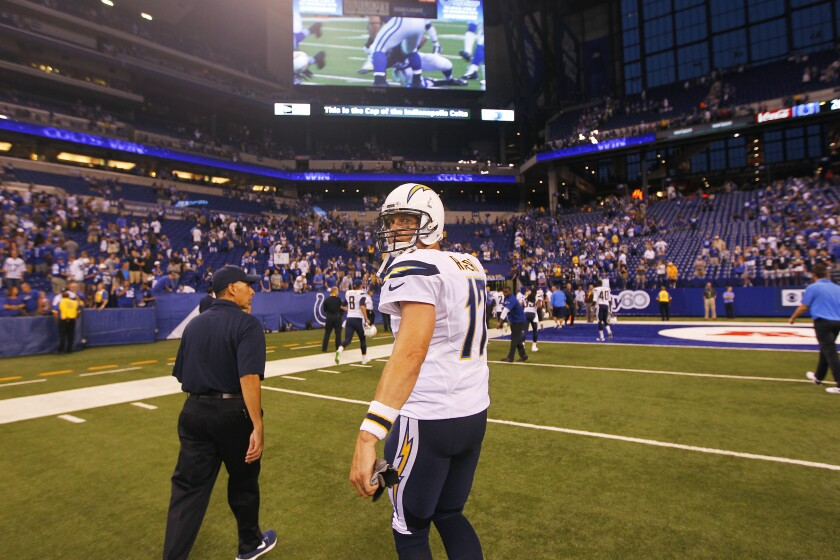 Philip Rivers, then with the San Diego Chargers, walks off the field after a 26-22 loss to the Indianapolis Colts in 2016 at Lucas Oil Stadium — which will now be his home stadium, according to reports.