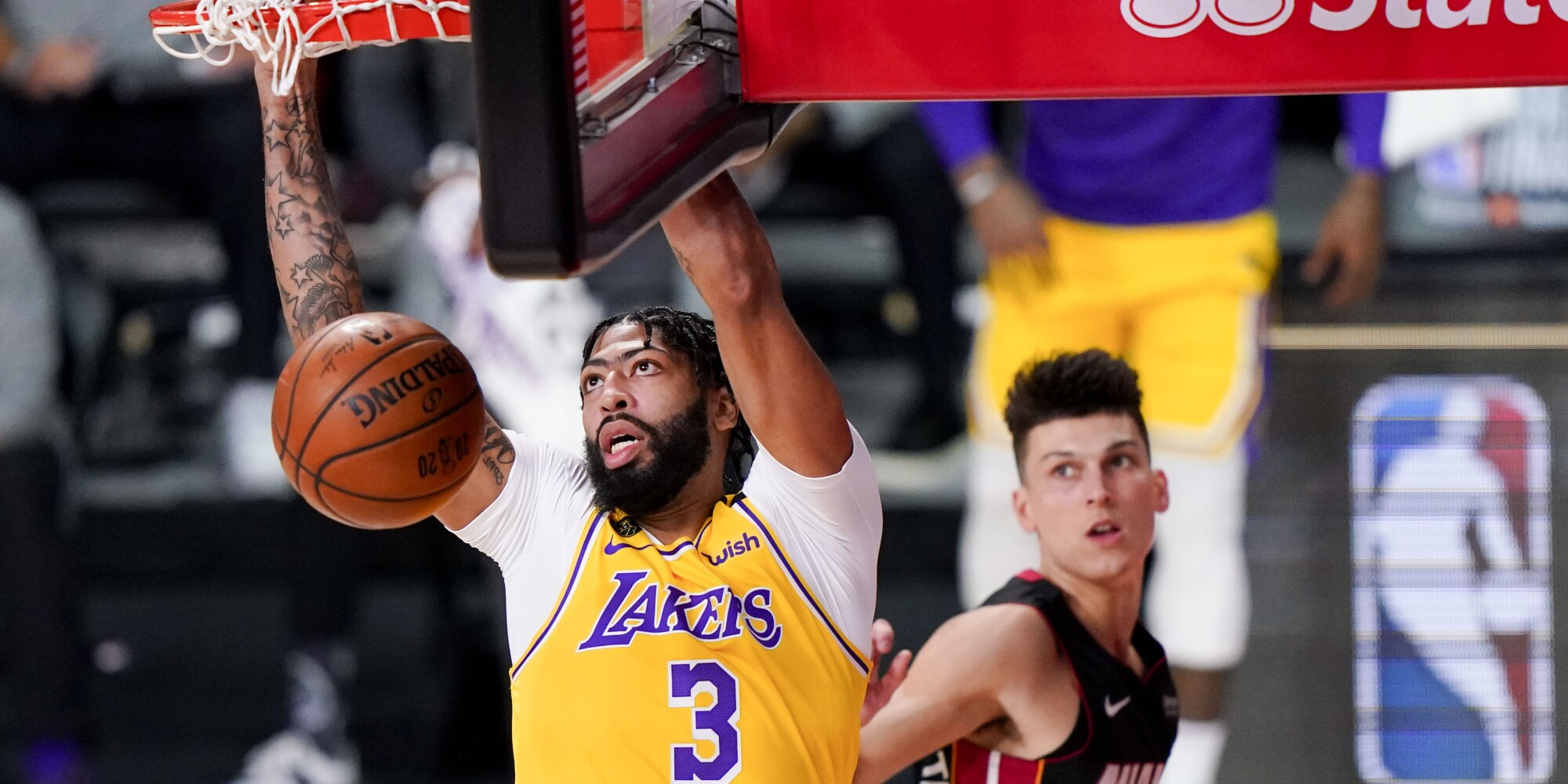 Lakers forward Anthony Davis throws down a dunk against the Heat early in Game 4 on Tuesday night.