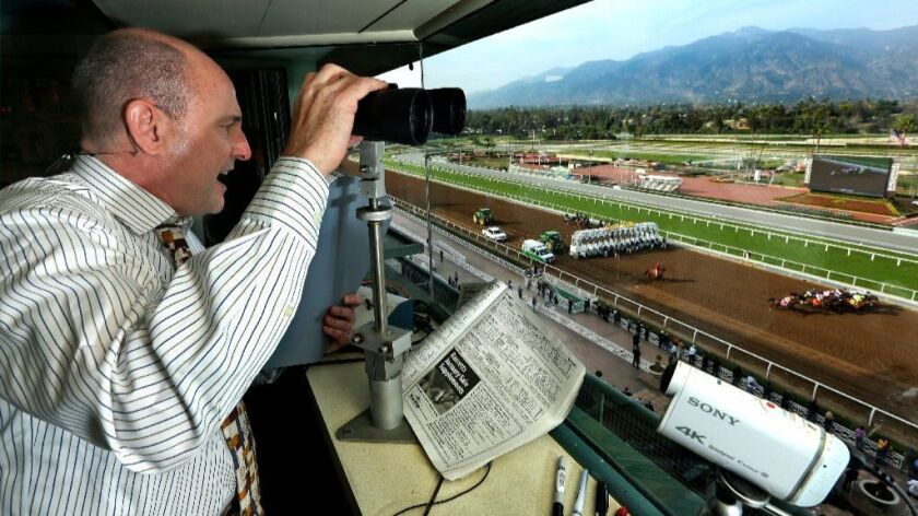 Michael Wrona calls a race at Santa Anita Park on Jan. 14, 2015.