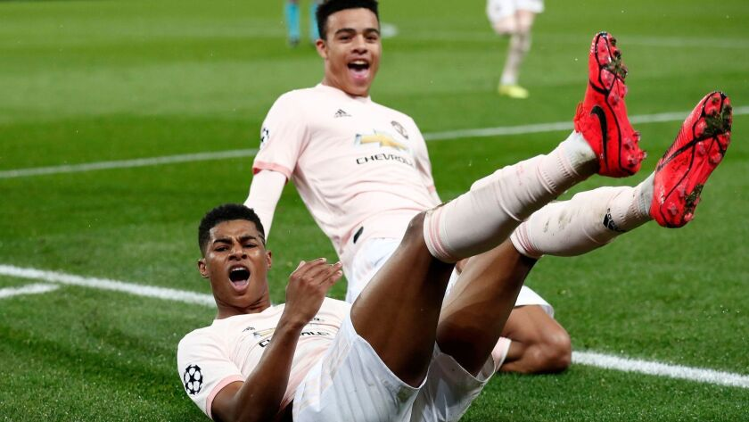 Manchester United's Marcus Rashford, left, and Mason Greenwood celebrate taking a 3-1 lead over Paris Saint-Germain during Champions League play Wednesday.