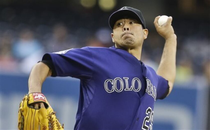 Colorado Rockies starting pitcher Jorge De La Rosa throws against the San Diego Padres in the first inning of a baseball game in San Diego, Wednesday, July 10, 2013. (AP Photo/Lenny Ignelzi)