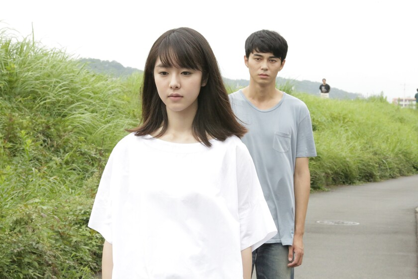 "Erika Karata and Masahiro Higashide in the movie ""Asako I & II."""