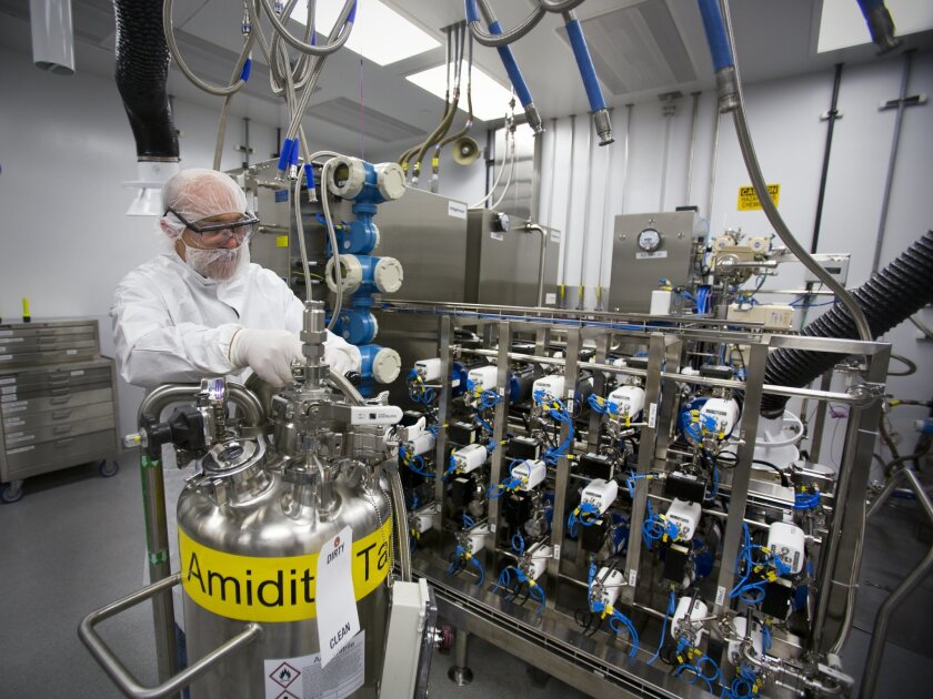 Max Moore shows drug-manufacturing equipment at Ionis Pharmaceuticals' plant in Carlsbad on Oct. 18, 2015.