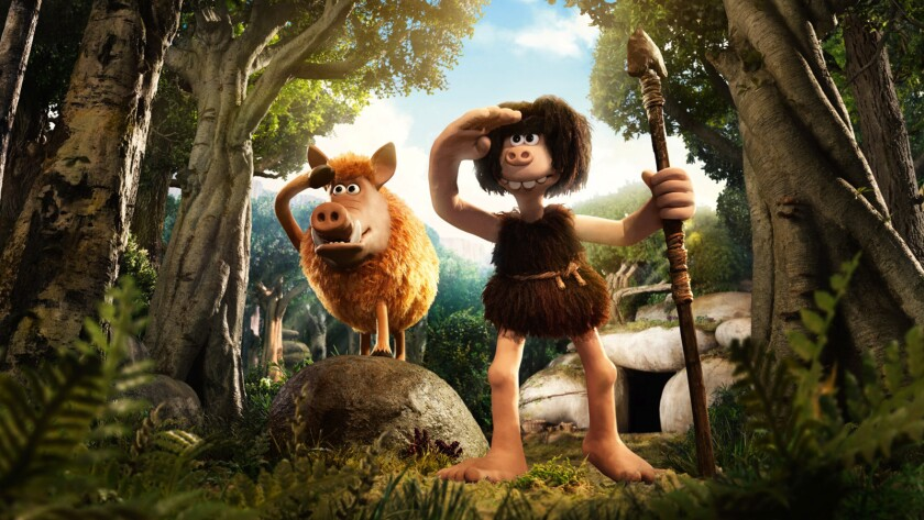 """Dug (voiced by Eddie Redmayne), right, and Hognob in the animated movie """"Early Man."""""""