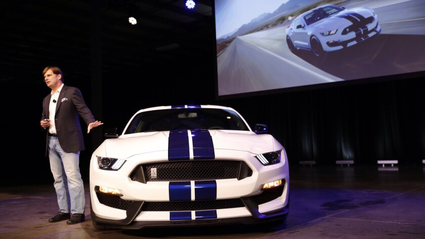 Jim Farley shows off the new Shelby GT350 Mustang in 2015.