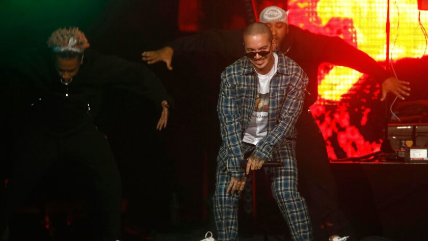 LOS ANGELES, CA - JANUARY 20, 2018 -- J Balvin, in plaid outfit, performs during the CALIBASH concer