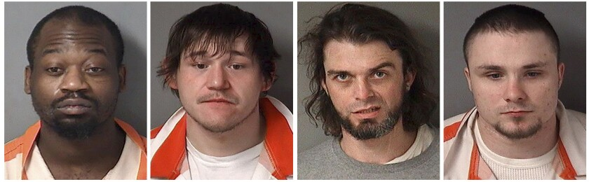 These undated photos provided by the Fulton County Sheriff's Department in Lewistown, Ill., shows, from left, Jesse Davis, 35, Cody Villalobos, 26, Zachary Hart, 36, and Eugene Roets, 23. The four inmates escaped from the Fulton County Jail in Lewistown on Wednesday, July 7, 2021. Authorities didn't immediately say how the men escaped, but said they should be considered armed and dangerous. (Fulton County Sheriff's Department via AP)