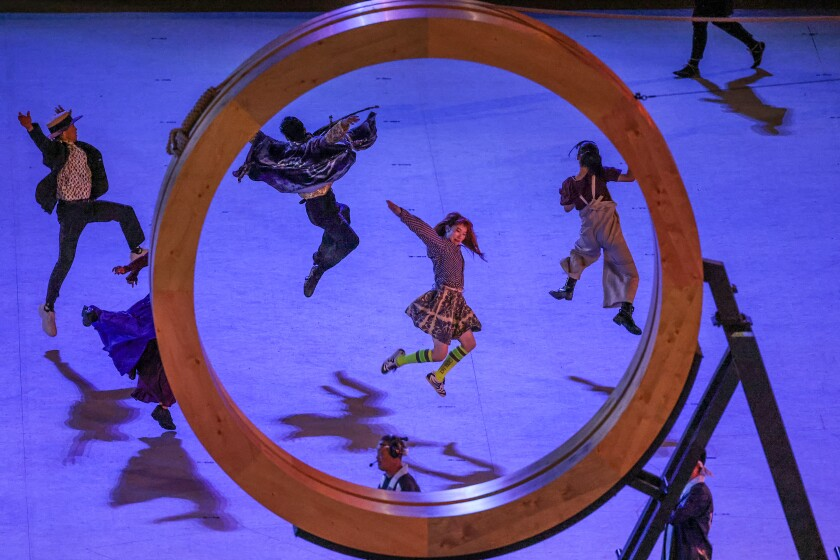 Dancers perform by a giant letter O at the Tokyo 2020 Olympics Opening Ceremony at Olympic Stadium.