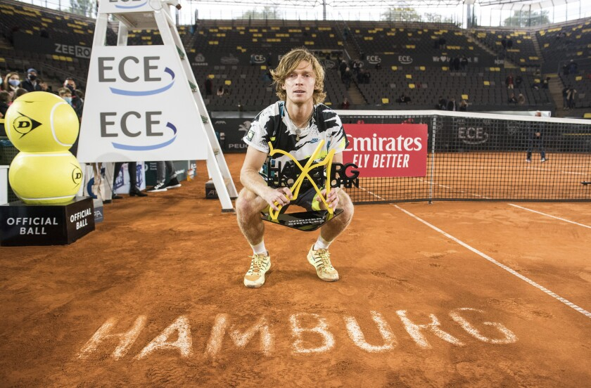 Andrey Rublev of Russia holds the trophy after his victory against Stefanos Tsitsipas of Greece at the ATP Tour - European Open in Hamburg, Germany, Sunday, Sept. 27, 2020. The 22-year-old defeated the number two seeded Greek 6-4, 3-6, 7-5 in the final. (Daniel Bockwoldt/dpa via AP)