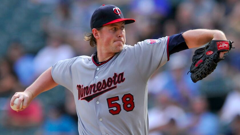 Right-hander Tim Melville was claimed off waivers by the Padres on Saturday.