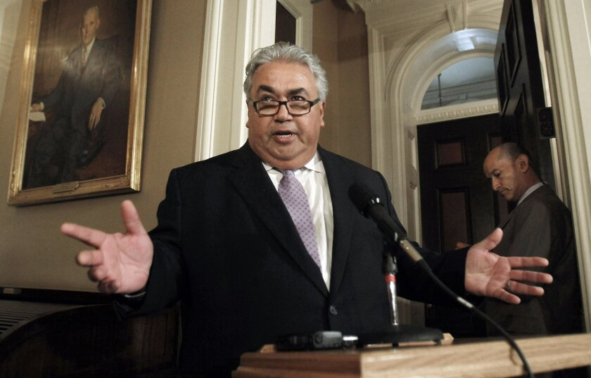 FILE - In this Monday June 10, 2013, file photo, State Sen. Ron Calderon, D-Montebello, talks to reporters during his first appearance at the Capitol after FBI investigators raided his offices the previous week in Sacramento, Calif.   By a unanimous vote the Senate Rules Committee voted, Tuesday No