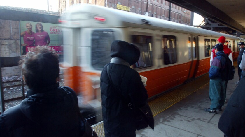 Commuters wait for trains at Sullivan Square Station on the Orange Line of Boston subway system. A new study provides the first analysis of microbes found on the city's subways.