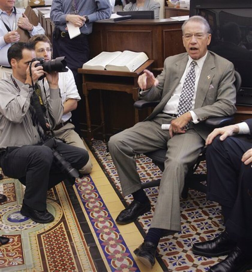 In this Sept. 26, 2007, file photo Sen. Charles Grassley, R-Iowa, talks to reporters in his Capitol Hill office in Washington. U.S. banks that are collecting billions of dollars in taxpayer loans to stay afloat sought government permission to import thousands of foreign workers for high-paying jobs in the United States, an Associated Press investigation has found. The job losses anger lawmakers like Sen. Charles Grassley, who is pushing legislation to make employers recruit American workers first, along with other reforms to the visa program. (AP Photo/Lawrence Jackson, File)