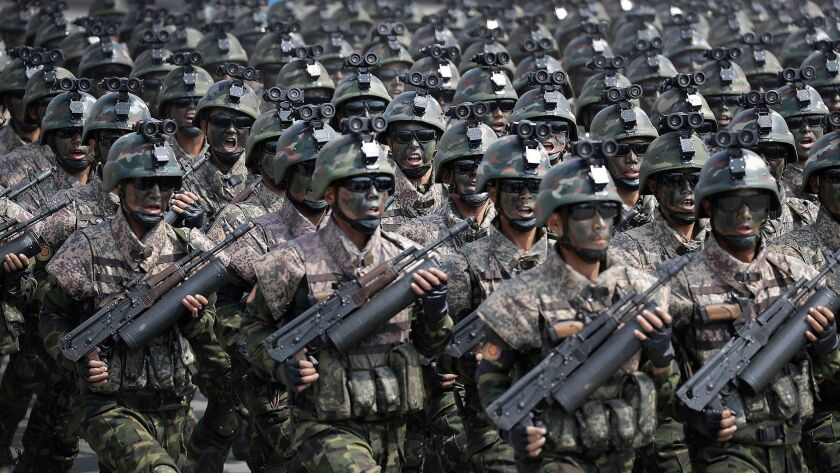 Commandos march across Kim Il Sung Square during a military parade in Pyongyang, North Korea.