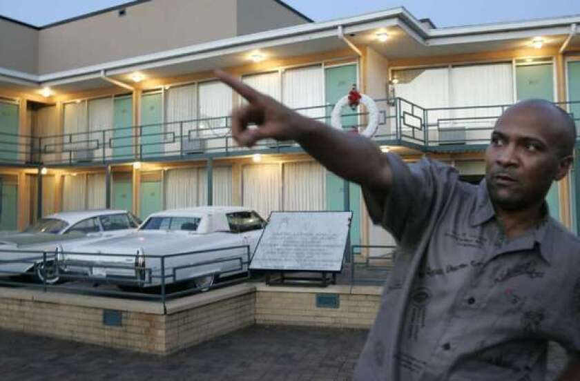 During a visit to the National Civil Rights Museum, Memphis resident David Tate tells visiting family, in July 2007, the direction from which a gunman fired a shot that killed Martin Luther King Jr.