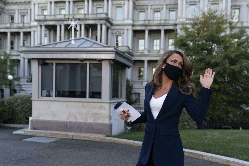 White House director of strategic communications Alyssa Farah waves after speaking at the White House on Oct. 8