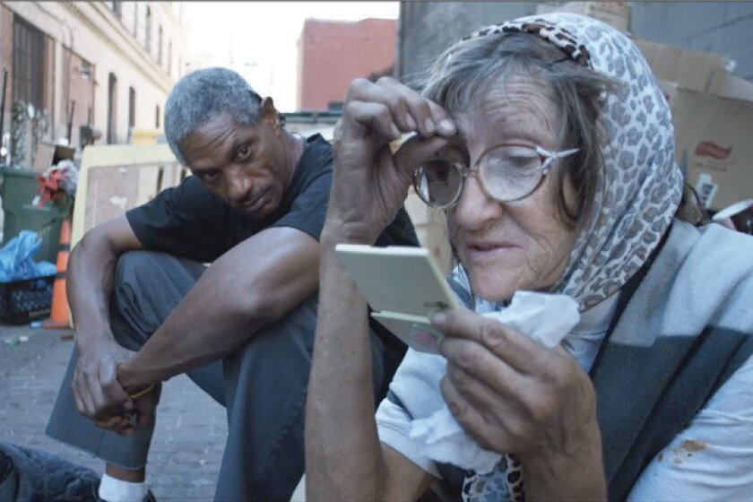 "Kevin ""KK"" Cohen, left, and Lee Anne ""Cat Lady"" Leven are among the skid row residents featured in the documentary ""Lost Angels,"" which opens Friday. Cohen was fatally shot on skid row after filming was completed."