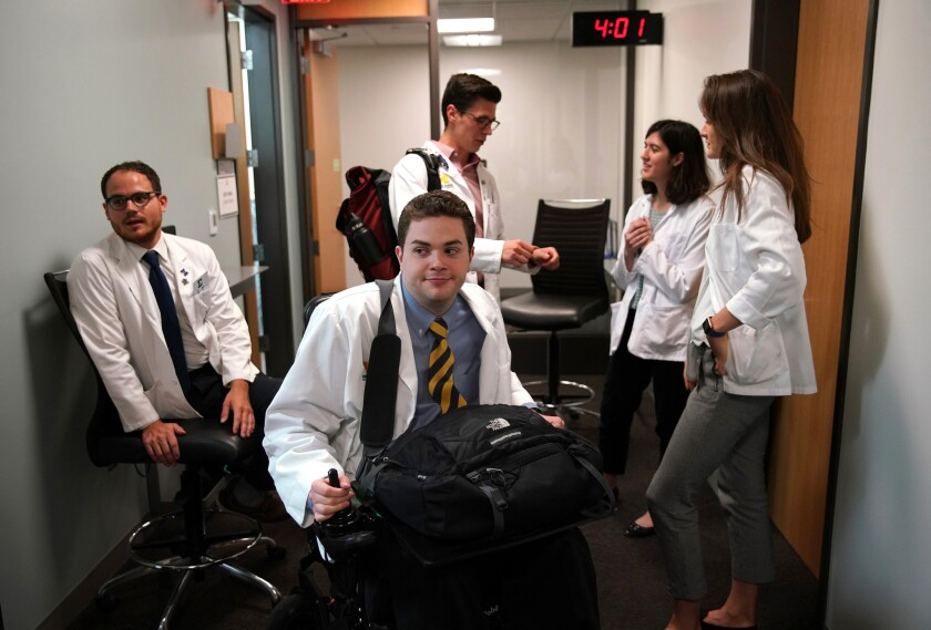 Chris Connolly navigates the halls at the University of Michigan medical school, June 21, 2018. Chris is a quadriplegic and one of few disabled students to have been admitted to medical school.