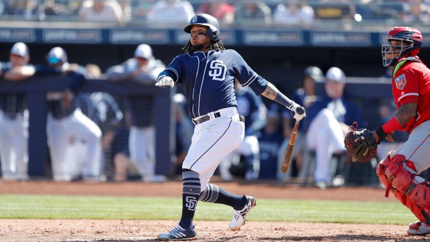 Padres shortstop Freddy Galvis bats during the second inning of a spring training game against the Angeles on Monday.