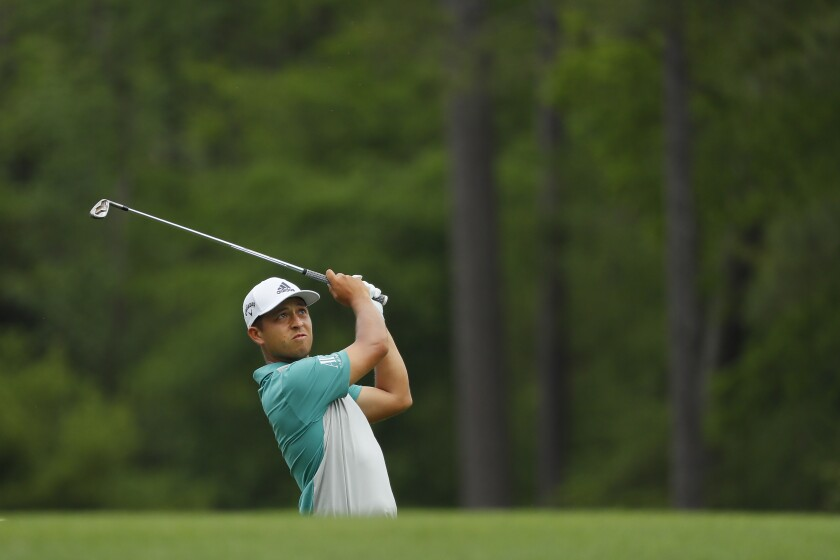 Xander Schauffele of San Diego plays a shot on the 12th hole during the second round of the Masters at Augusta National Golf Club on Friday in Augusta, Ga.