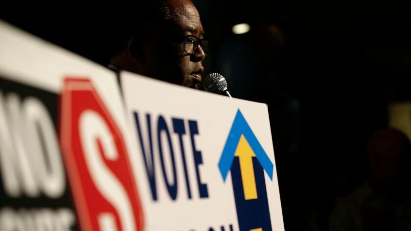 L.A. County Supervisor Mark Ridley-Thomas offers words of encouragement to supporters of Measure H as they wait for returns on election night.