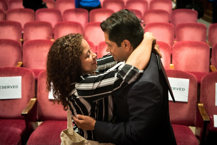 Jimmy Gomez gets a hug from his wife, Mary Hodge, before a 34th Congressional District debate.
