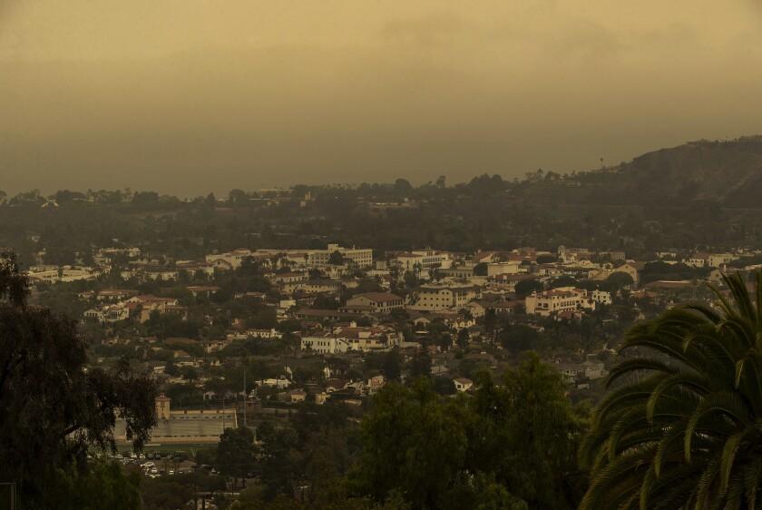 An orange haze from wildfire smoke covers Santa Barbara