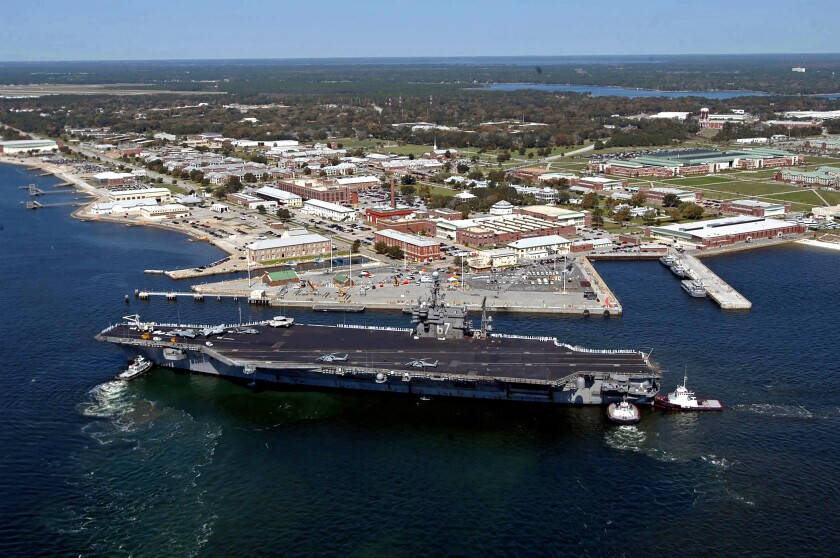 An aerial view of the aircraft carrier John F. Kennedy arriving for a port visit at Naval Air Station Pensacola, in Pensacola, Fla., in 2004.