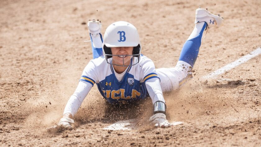 UCLA sophomore Briana Perez slides in to home plate scoring the Bruin's only run of game one of the