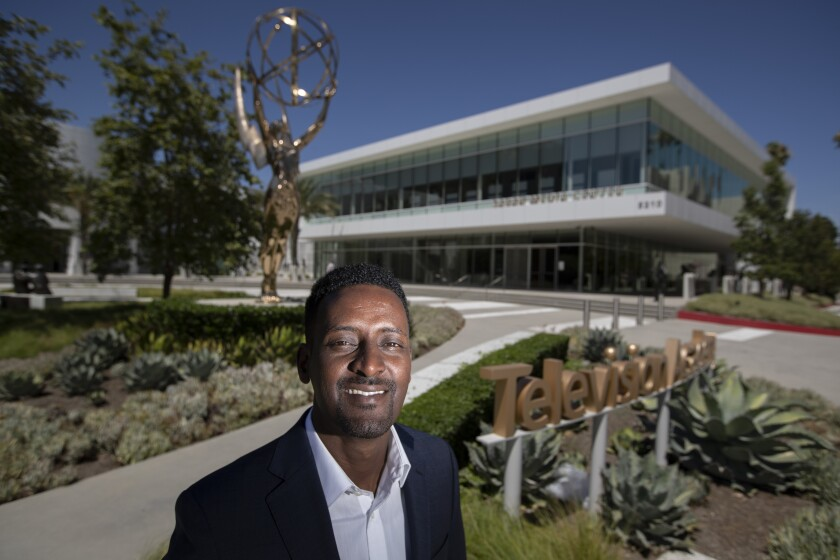 Hussen in front of an Emmy statue outside the Television Academy offices in North Hollywood.