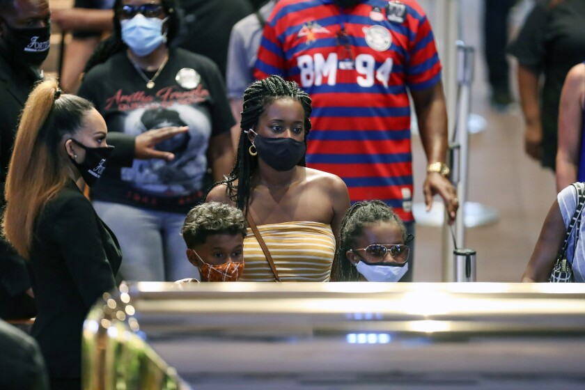 Mourners view the casket of George Floyd