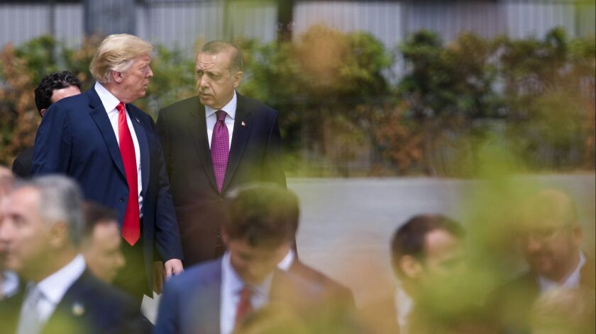 President Trump and President Erdogan during the opening ceremony of the NATO summit July 11, 2018, in Brussels, Belgium.